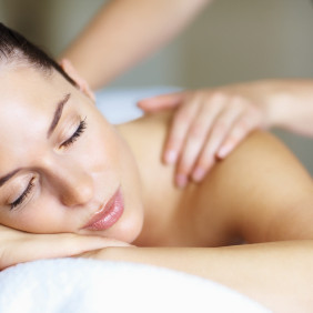 Closeup of relaxed woman receiving back massage at spa